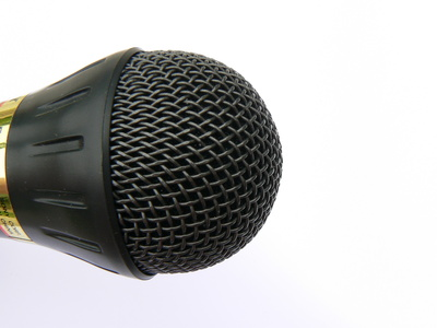 How to Play a Microphone Through PC Speakers