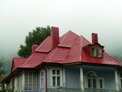 Estilos de pintura de exterior para un techo rojo ehow for Techos de metal para casas