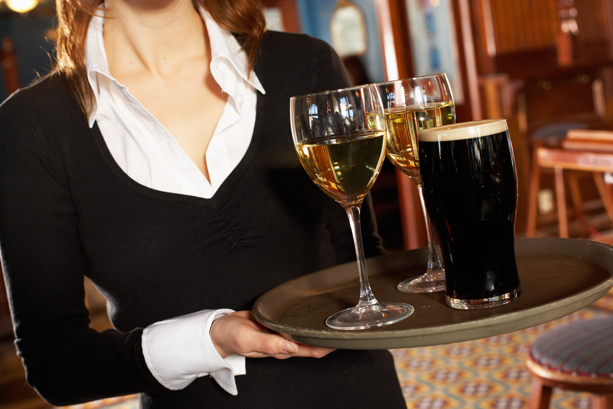 tips on a new waitress carrying drink trays