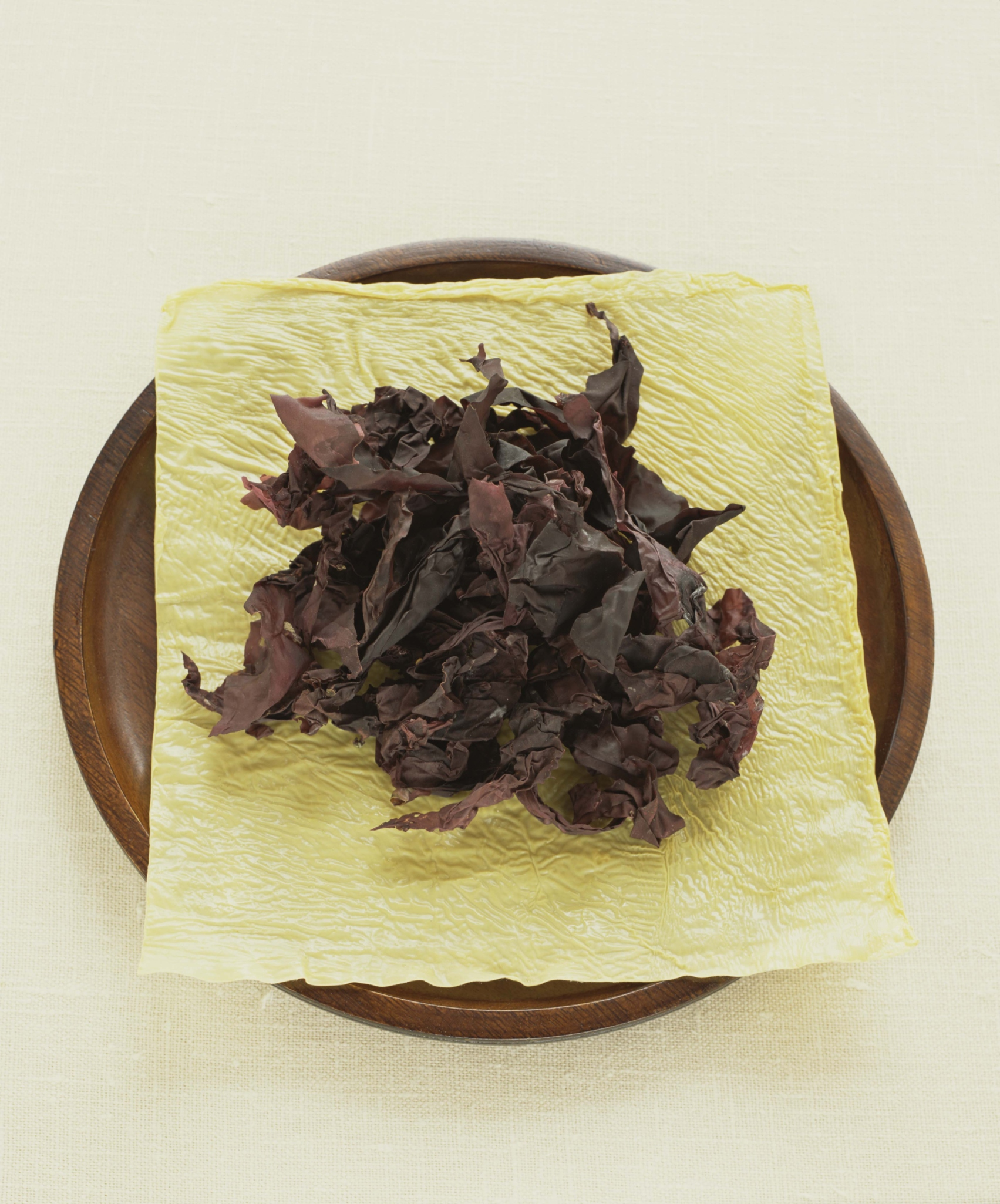 Heat from roasting reduces enzyme levels in seaweed.