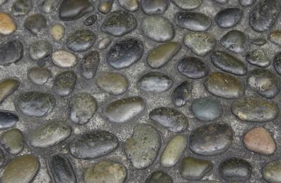 How to lay river pebble pavers home guides sf gate for Installing river rock tile