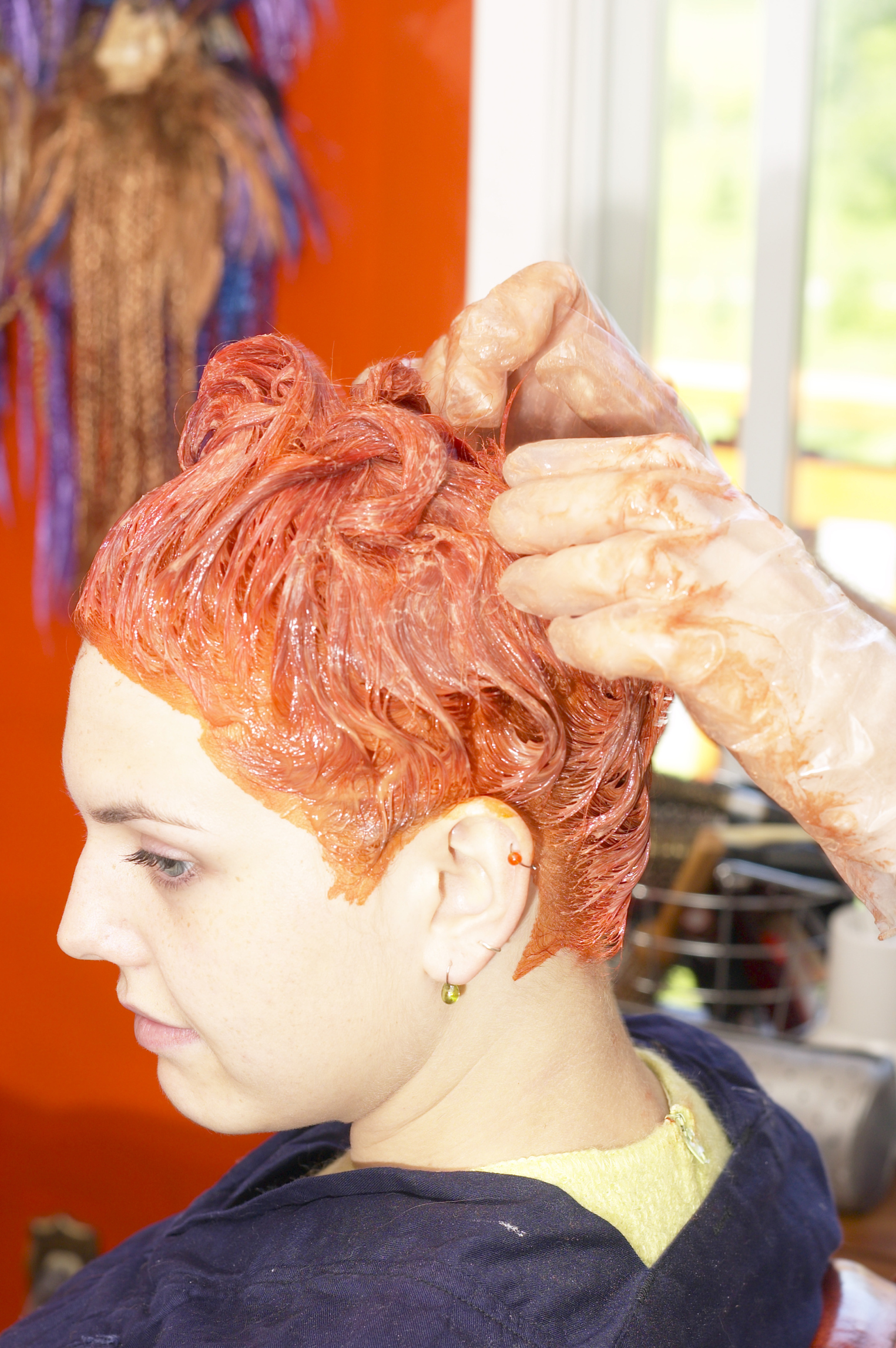 Anecdotal evidence suggests vitamin C tablets crushed in shampoo may remove hair dye.