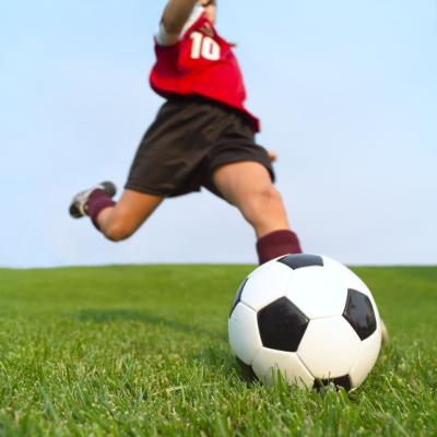 kicking soccer ball. How Kids Should Kick a Soccer