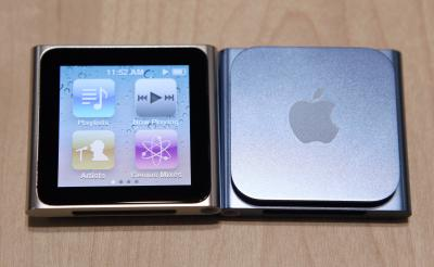 The iPod Nano charges via the dock on the bottom of the device.