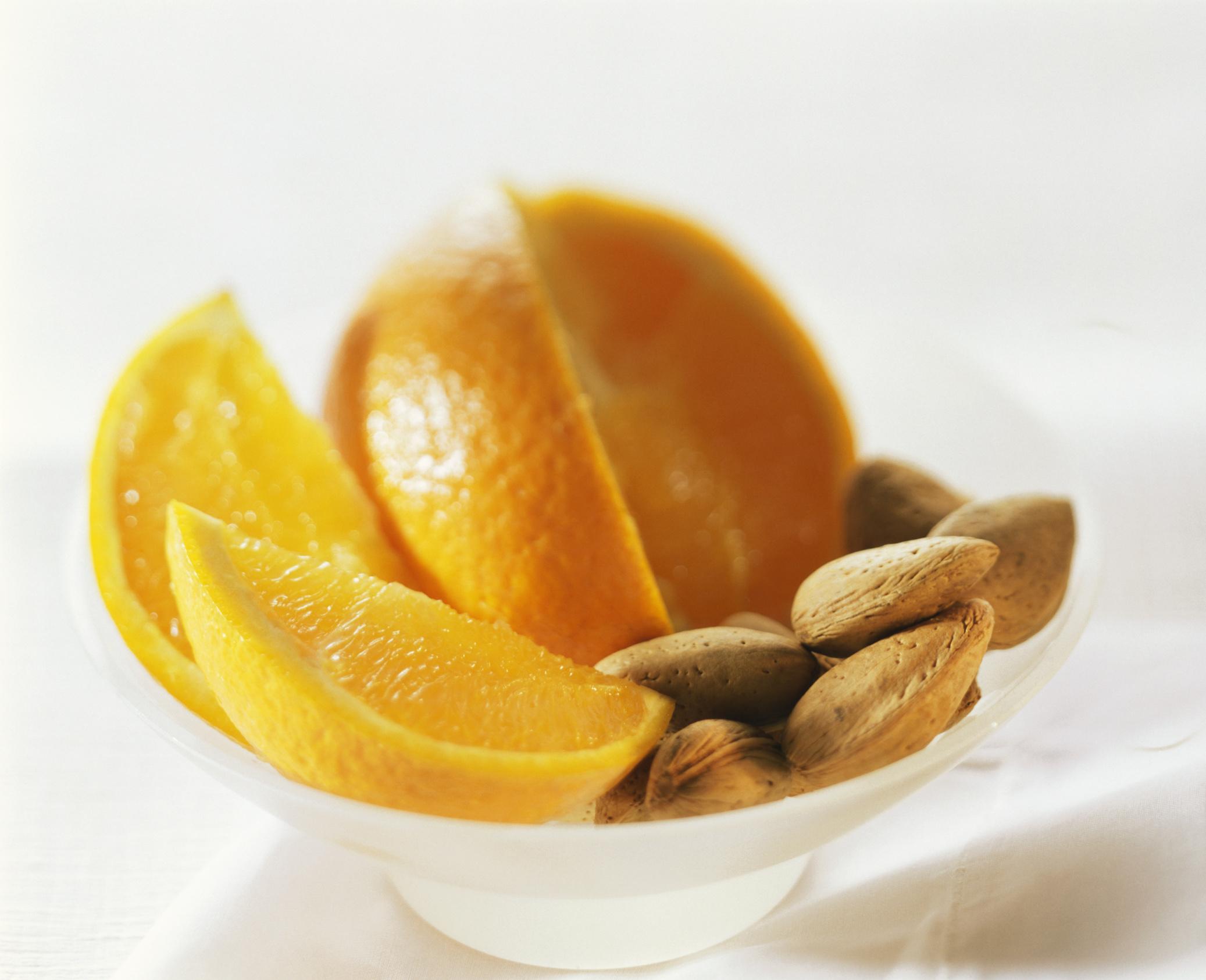 Oranges are rich in vitamin C, but almonds provide none.