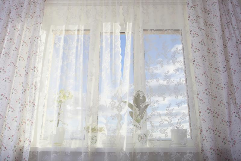 How to put curtains on a long narrow window above my bed for Narrow window