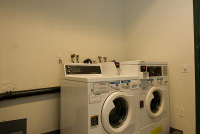 How To Decorate A Small Laundry Room With Exposed Pipes