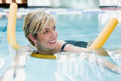 Swimming Pool Exercises Using An Aqua Noodle Livestrong Com