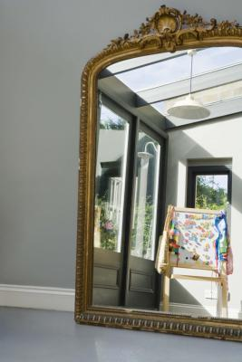 how to use mirrors to increase the sunlight in your home