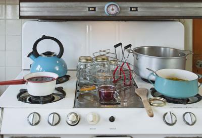 Comparing cleaning an enamel cooktop vs glass cooktop for Glass cooktops pros and cons