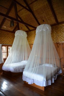 C mo hacer un mosquitero para cama ehow en espa ol for Mosquiteras para camas