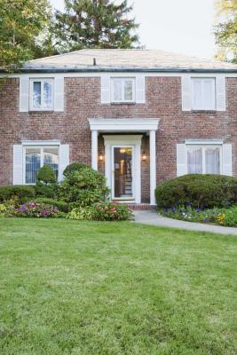 What Colors Of Landscaping Rocks Go With Red Brick Home