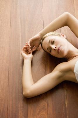 a yin yoga shoulder pose using a block  healthy living