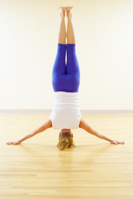 benefits  risks of yoga headstands  get fit  jillian